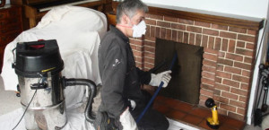 cleaner working on fireplace